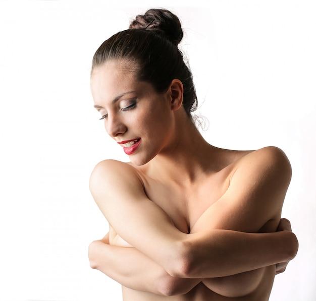 Naked woman hugging herself Premium Photo