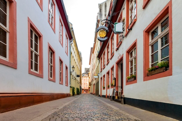 Narrow street with historic traditional houses and cobbled street in an old town in europe Premium Photo