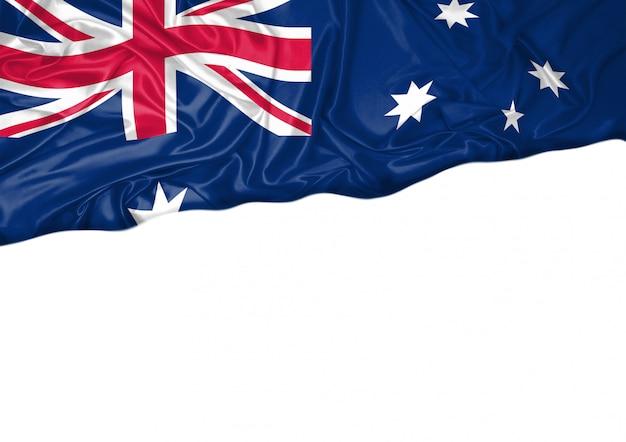 National flag of australia hoisted outdoors with white background. australia day celebration Premium Photo
