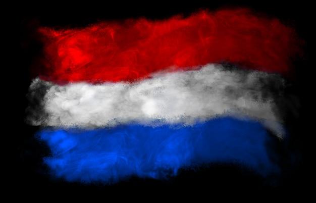 色の煙で作られたオランダの国旗 Premium写真