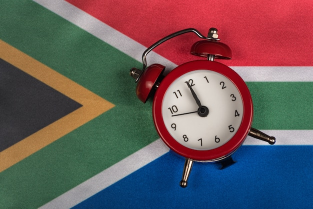 National flag of republic of south africa and alarm clock Premium Photo