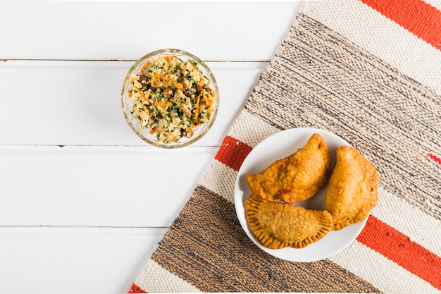 National oriental salad and pasties Free Photo