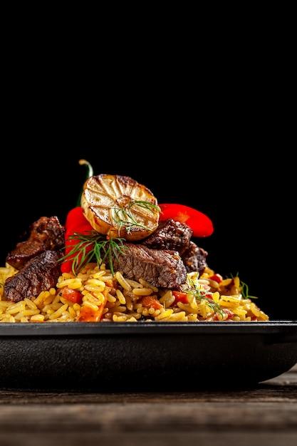 National uzbek pilaf with meat. Premium Photo