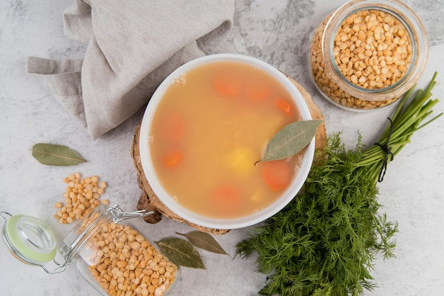 Natural chickpeas soup in bowl with bay leaf Free Photo