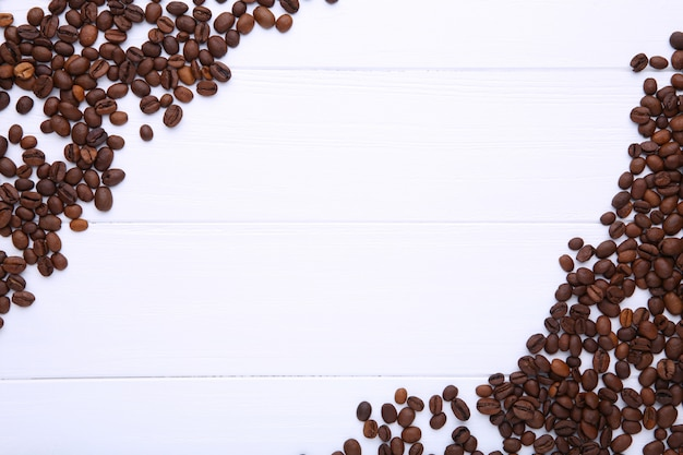 Natural coffee beans on white wooden Premium Photo