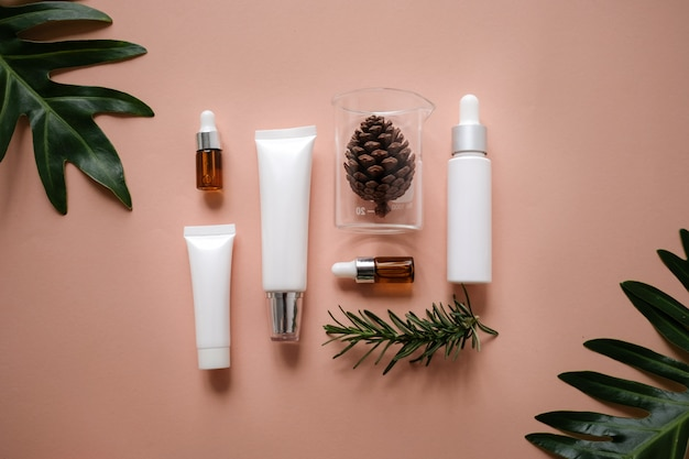 Natural cosmetic cream , serum, skincare blank bottle packaging with leaves . Premium Photo