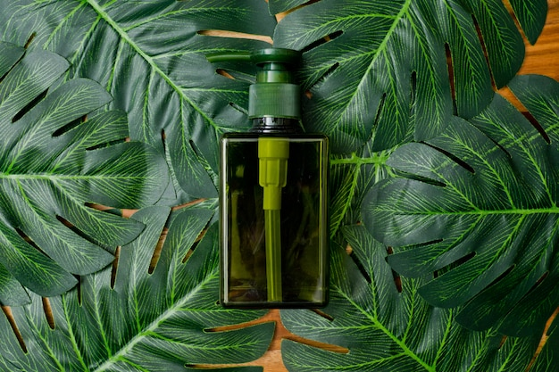 Natural cosmetics bottle containers on green leaf background, empty bottle ,natural beauty skincare product, Premium Photo