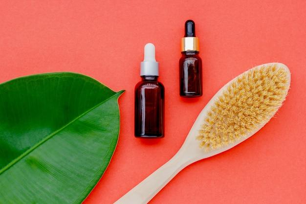 葉が付いているびんの自然派化粧品 Premium写真