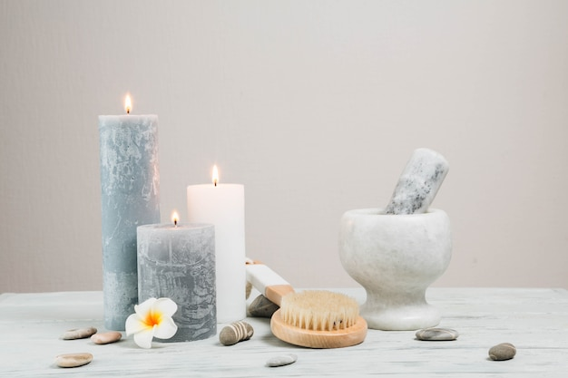 Natural elements for spa with candles Free Photo