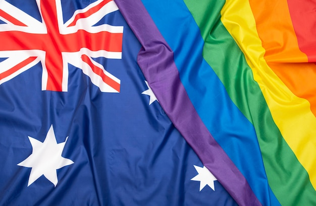 Natural fabric flag of australia and lgbt rainbow flag as texture or background, concept picture about human rights Premium Photo