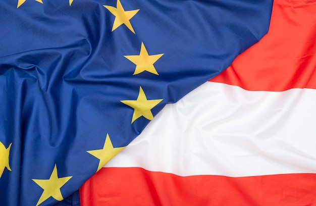 Natural fabric flag of austria and eu european union flag as texture or background Premium Photo
