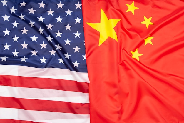 Natural fabric flag of the united states and flag of china, concept picture Premium Photo