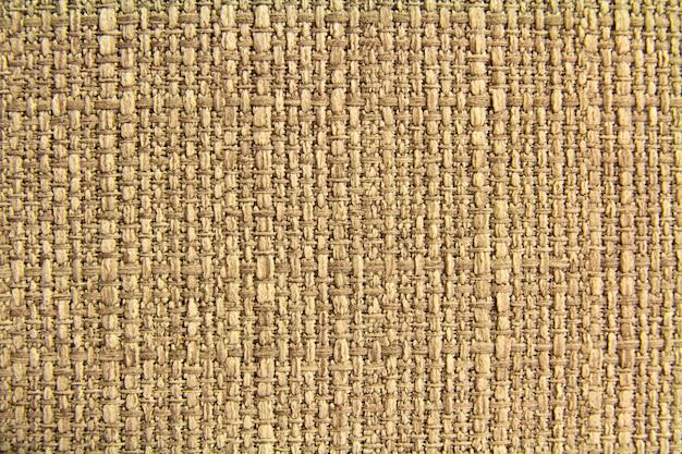 Натуральная ткань льняная текстура для дизайна, вретище текстурированная. коричневый холст. хлопок. Premium Фотографии