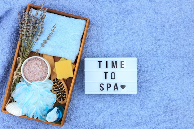 Natural herbal spa cosmetics with lavender extract - soap, salt, towel, massage brush, washcloth Premium Photo