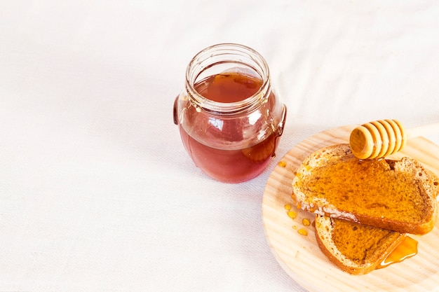 Natural honey and bread for healthy breakfast isolated on white surface Free Photo