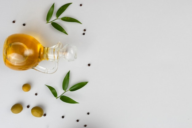 Natural olives and olive oil on table Free Photo