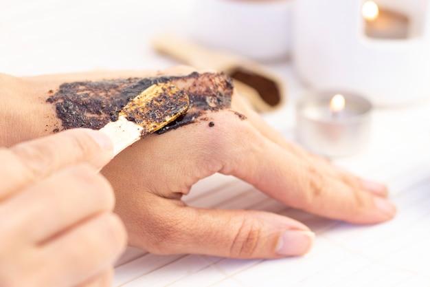 Natural scrub made from coffee and sugar. hand peeling sugar scrub with coffee. spa hand treatment. Premium Photo