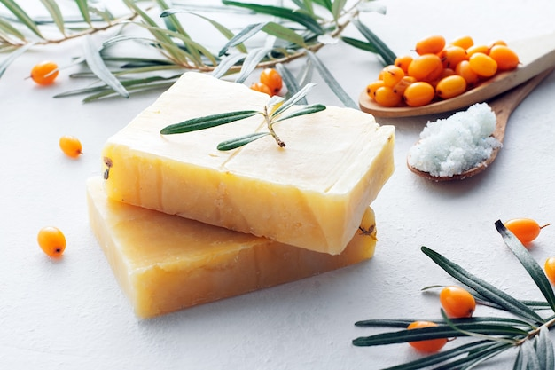Natural sea buckthorn soap close-up on a white background. Premium Photo