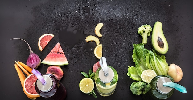 Natural smoothie drink on a black wall. flat lay. top view. Free Photo