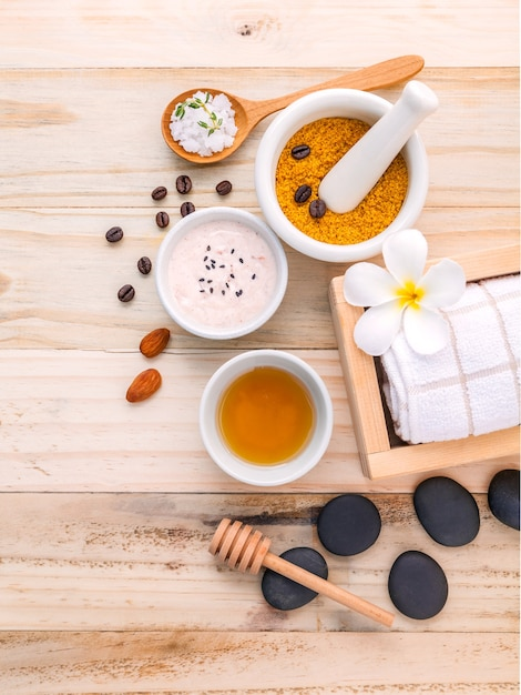 Natural spa ingredients and white mortar on wooden background ...