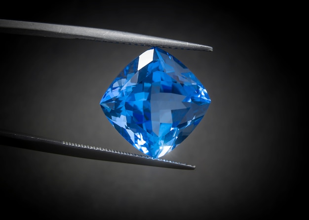 Natural swiss blue topaz cushion shape gemstone oval cut beautiful. Premium Photo