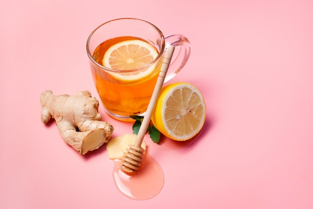 Natural treatment for colds and flu. ginger lemon honey garlic and rose hip tea against influenza. hot tea for colds. home pharmacy. proven treatment of diseases. folk medicine. Premium Photo
