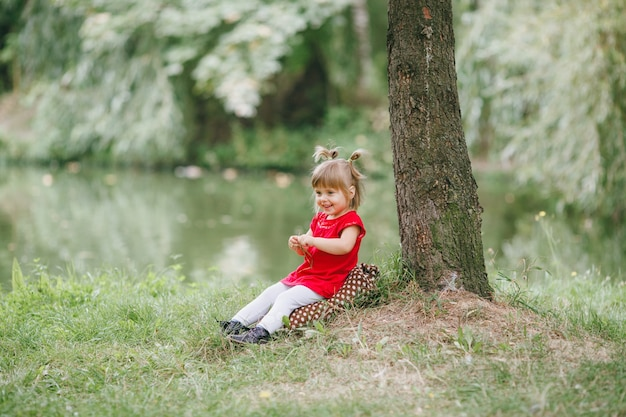 Nature little cheerful red daughter photo premium download for Cheerful nature