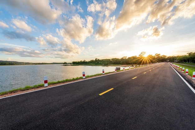 Nature new road water side at sunset time Premium Photo