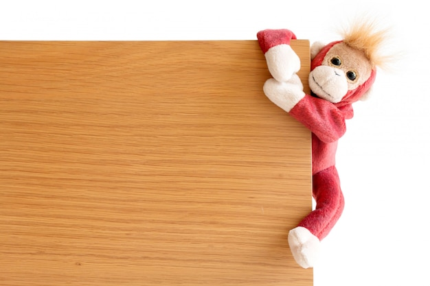 Naughty monkey is catching on the wood board Premium Photo