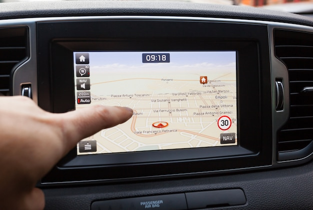 https://image.freepik.com/free-photo/navigation-panel-inside-car-finger-pointing-destination-point_87414-1024.jpg