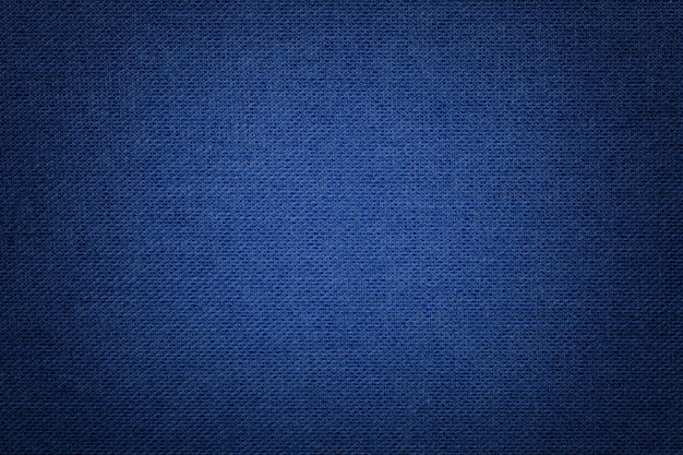 Navy blue background from a textile material with wicker pattern, closeup. Premium Photo