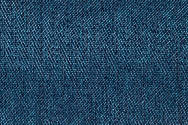 Navy blue background from woolen texture textile, closeup. structure of the wicker fabric macro. Premium Photo
