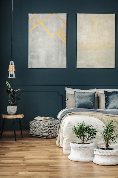 Navy blue bedroom with art Premium Photo