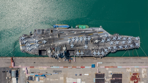 Navy nuclear aircraft carrier, military navy ship carrier full loading fighter jet aircraft, aerial view. Premium Photo