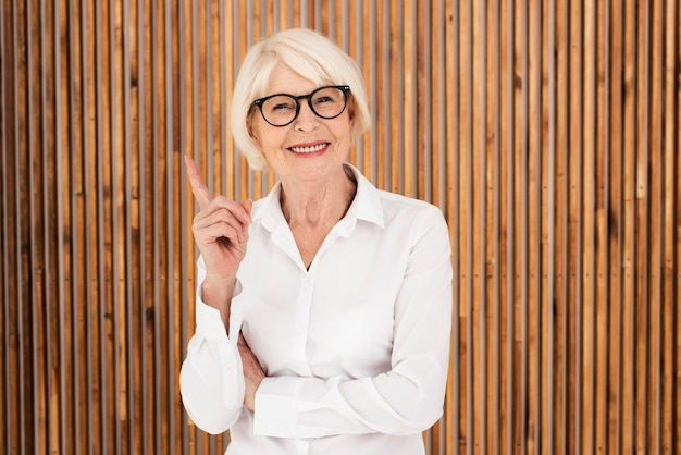 Neat old woman with eyeglasses Free Photo