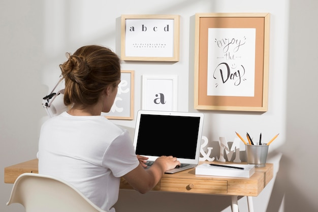 Neat and organised workspace with laptop Free Photo