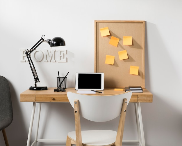 Neat and tidy workspace with tablet on desk Free Photo