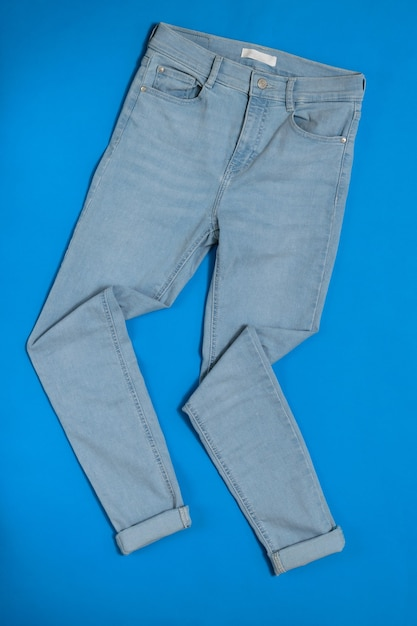 Neatly stacked on blue of women's jeans Premium Photo