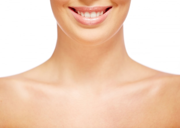 Neck close-up of a natural woman Free Photo