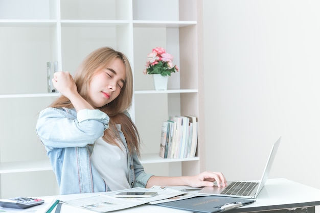 Premium Photo | Neck pain in asian women office syndrome