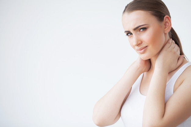 Neck pain. woman in pain. beautiful girl feeling toothache Premium Photo
