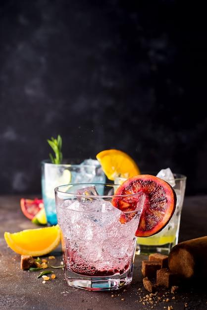 Negroni cocktail on dark stone table. Premium Photo