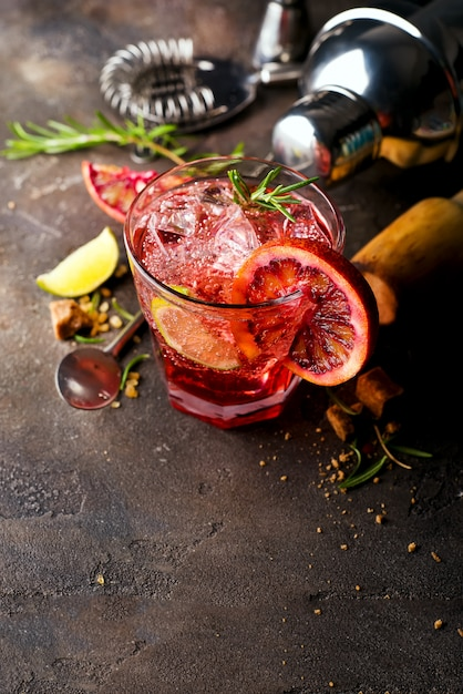 Negroni coctail standing on the stone background Premium Photo