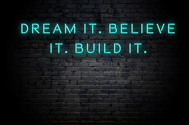 Neon inscription of positive wise motivational quote against brick wall Premium Photo