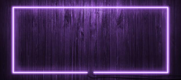 Neon light on wooden wall background. Premium Photo