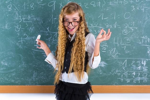 Nerd pupil blond girl in green board schoolgirl Premium Photo