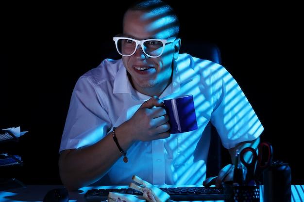 Nerd surfing internet at night time Free Photo