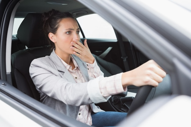 Nervous businesswoman crashing her car Premium Photo
