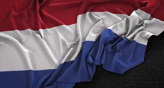 Netherlands flag wrinkled on dark background 3d render Free Photo