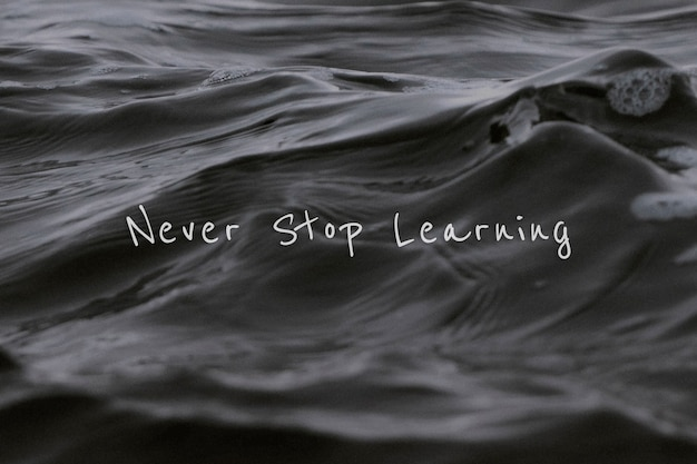 Never stop learning quote on a water wave Free Photo